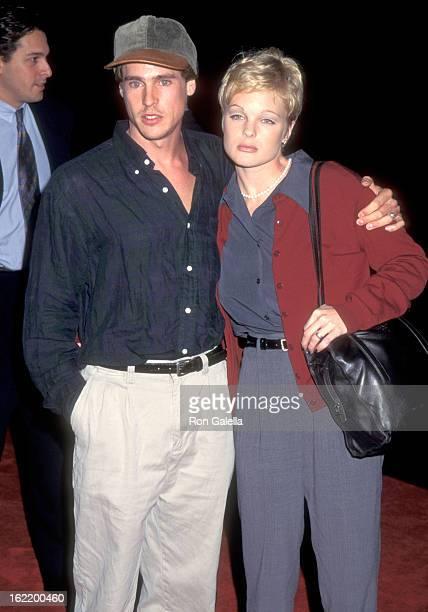 Actors William McNamara and Erika Eleniak attend the Copycat Burbank Premiere on October 19 1995 at Warner Bros Studios in Burbank California