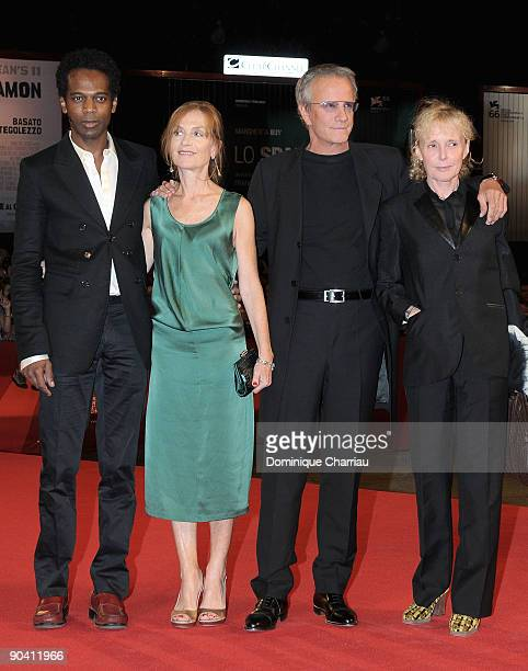 Actors William Nadylam Isabelle Huppert Christophe Lambert and director Claire Denis attend the White Material premiere at the Sala Grande during the...