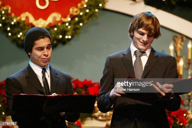 Actors Wilmer Valderrama and Ashton Kutcher perform on stage at the Church of Scientology's 11th Annual Christmas Stories Fundraiser to benefit the...