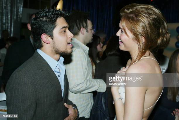Actors Wilmer Valderrama and Mandy Moore talk at the afterparty for United Artists' Saved at the Beverly Hills Community Sports Center on May 13 2004...