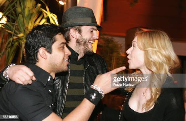 Actors Wilmer Valderrama Ashton Kutcher and Laura Prepon share a joke at the Fox Television 'That 70s Show' wrap party held at Tropicana at The...