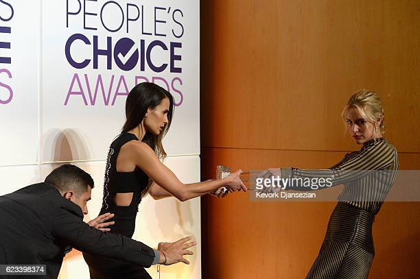 Actors Wilmer Valderrama Jordana Brewster and Piper Perabo hold the People's Choice Award during the mannequin challenge during the People's Choice...