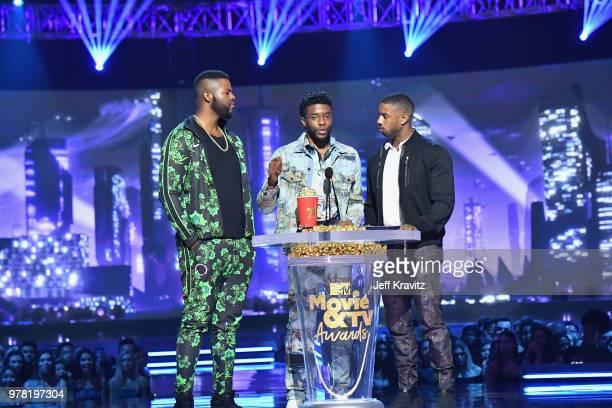 Actors Winston Duke Chadwick Boseman and Michael B Jordan accept award onstage at the 2018 MTV Movie And TV Awards at Barker Hangar on June 16 2018...