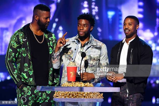 Actors Winston Duke Chadwick Boseman and Michael B Jordan accept the Best Movie award for 'Black Panther' onstage during the 2018 MTV Movie And TV...