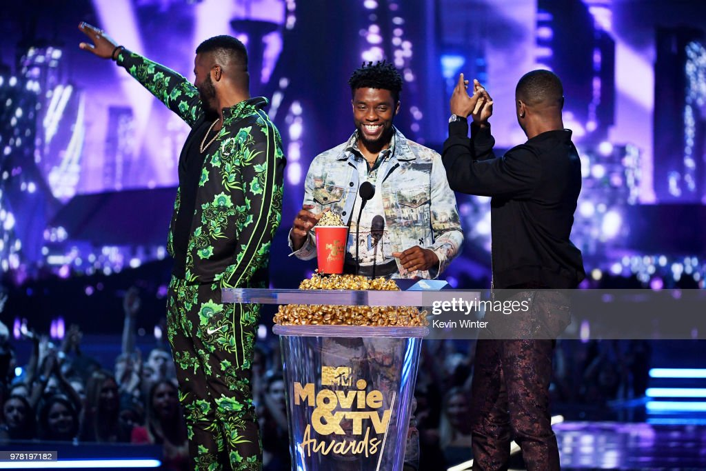 Actors Winston Duke, Chadwick Boseman, and Michael B. Jordan accept the Best Movie (Presented by Toyota) award for 'Black Panther' onstage during the 2018 MTV Movie And TV Awards at Barker Hangar on June 16, 2018 in Santa Monica, California.