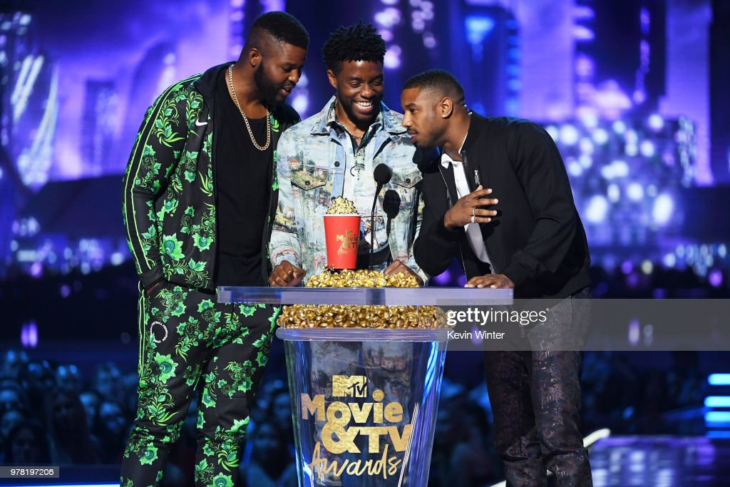 Actors Winston Duke, Chadwick Boseman, and Michael B. Jordan accept the Best Movie award (Presented by Toyota) for 'Black Panther' onstage during the 2018 MTV Movie And TV Awards at Barker Hangar on June 16, 2018 in Santa Monica, California.