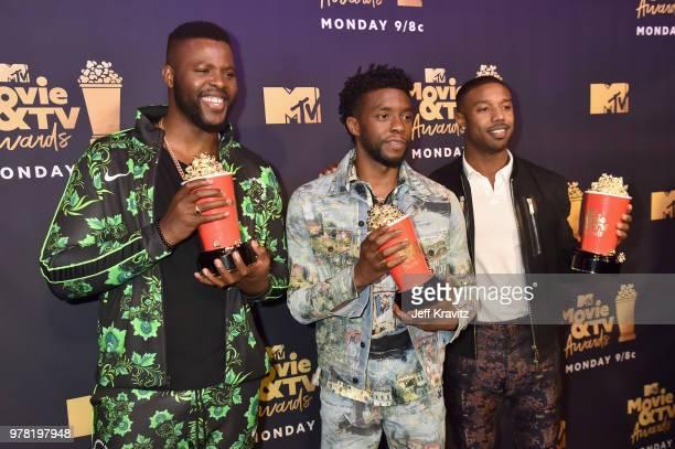 Actors Winston Duke Chadwick Boseman and Michael B Jordan attend the 2018 MTV Movie And TV Awards at Barker Hangar on June 16 2018 in Santa Monica...