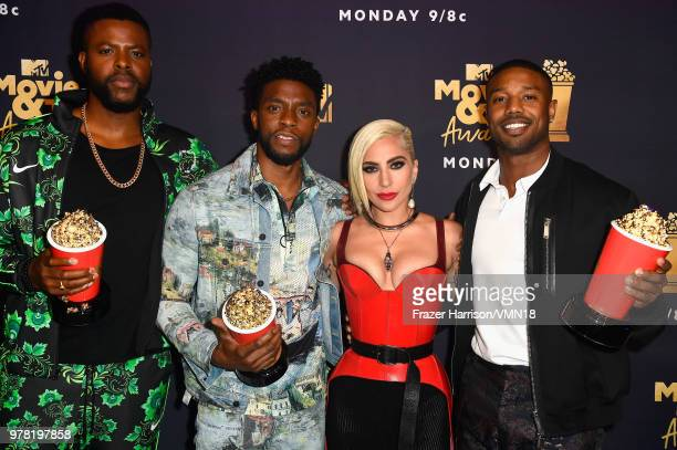 Actors Winston Duke Chadwick Boseman and Michael B Jordan with the Best Movie Best Hero and Best Villain awards for 'Black Panther' attend the 2018...