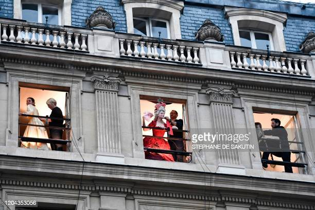 Actors with costumes and employees of the Comedie Francaise perform on the balconies of the Comedie Francaise to protest against the pension reform...