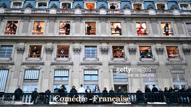 TOPSHOT Actors with costumes and employees of the Comedie Francaise perform on the balconies of the Comedie Francaise to protest against the pension...