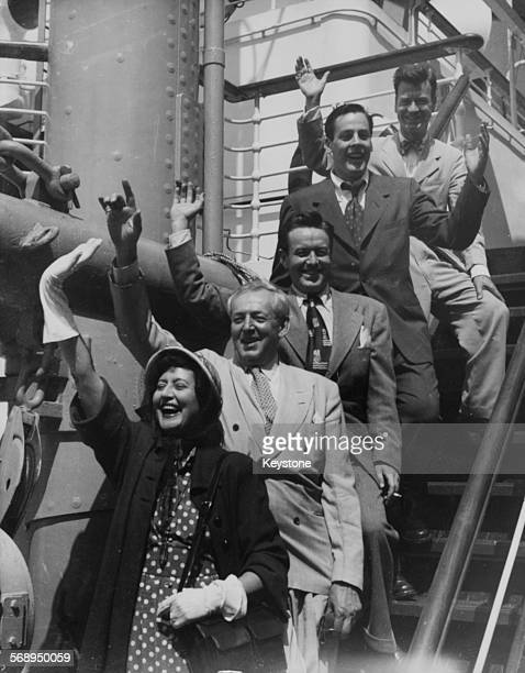 Actors with the Road Company of the United States Sam Mann Kevin McCarthy Frank Maxwell Ralph Theodore and Katherine Alexander waving as they board...