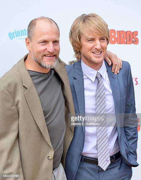 "Actors Woody Harrelson and Owen Wilson arrive at the premiere of Relativity Media's ""Free Birds"" at the Westwood Village Theatre on October 13, 2013..."