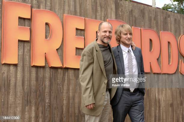 "Actors Woody Harrelson and Owen Wilson attend the premiere of Relativity Media's ""Free Birds"" at Westwood Village Theatre on October 13, 2013 in..."