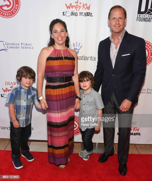 """Actors Wyatt Walters and Dylan Walters pose with family at """"Diary Of A Wimpy Kid: The Long Haul"""" Atlanta screening hosted by Dwight Howard at Regal..."""