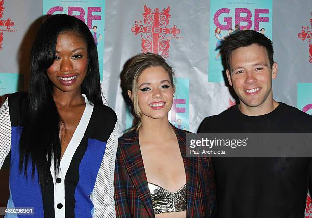 Actors Xosha Roquemore Sasha Pieterse and Taylor Frey attend the DVD release party for 'GBF' at The Abbey on February 13 2014 in West Hollywood...