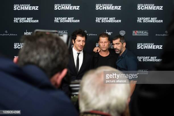 Actors Yalcin Gumer Til Schweiger and Erdal Yildiz arrive to the premiere of the film 'Der grosse Schmerz' from the TV series 'Tatort' in Berlin...