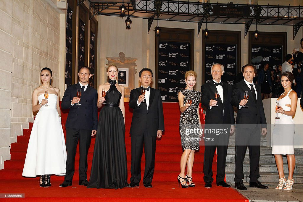 Actors Yao Chen, Clemens Schick, Amber Heard, Managing Director Montblanc China Thomas Kuh, actress Naomi Watts, CEO Montblanc International Lutz Bethge, actor Nicolas Cage and actress Jessica Alba attend the Montblanc international gala to celebrate the official opening of its new and biggest concept store in the world at the Montblanc Sanlitun Concept Store on June 1, 2012 in Beijing, China.