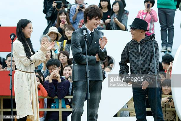 Actors Yu Aoi Masaki Okada and Japanese director Hiroki Ryuichi attend an audience meet and greet during day two of the Pusan International Film...