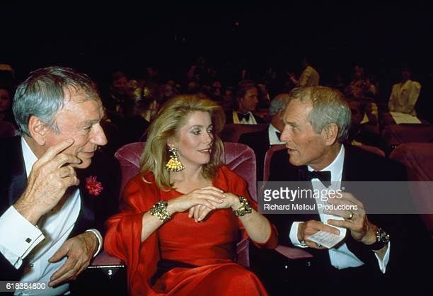 Actors Yves Montand Catherine Deneuve and Paul Newman attend the ceremony for the 40th anniversary of the Cannes Film Festival