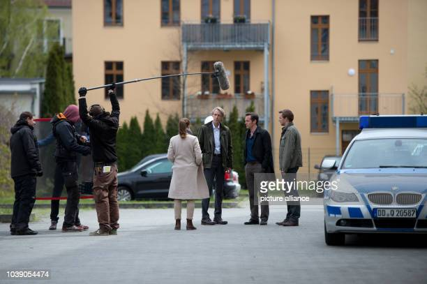Actors Yvonne Catterfeld as Commissar Viola Delbrueck Andreas Schmidt as Gregor Ebertin Jan Dose as Jakob Boehme and Johannes Zierner as Bjoern...
