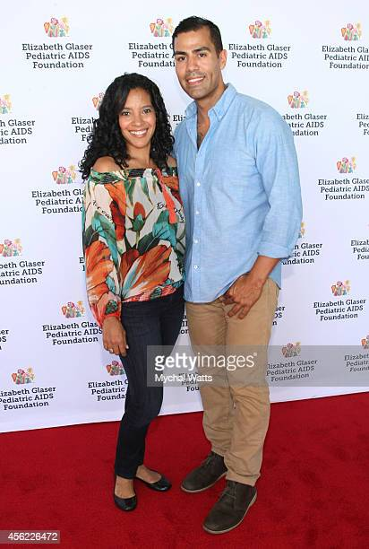 Actors Zabryna Guevara and JW Cortes attend Elizabeth Glaser Pediatric AIDS Foundation's Kids 4 Kid Family Festival at Chelsea Piers Field House on...