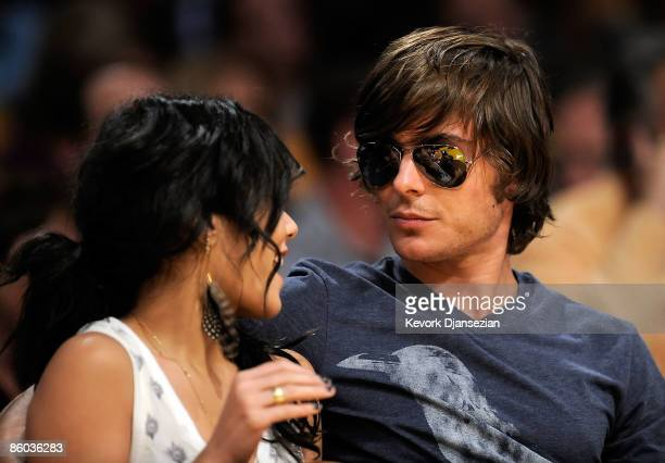 Actors Zac Efron and Vanessa Hudgens sit courtside during the Los Angeles Lakers and Utah Jazz Game One of the Western Conference Quarterfinals...