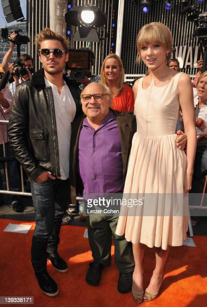 Actors Zac Efron Danny DeVito and Taylor Swift arrive at the Dr Seuss' The Lorax Los Angeles Premiere at Universal Studios Hollywood on February 19...