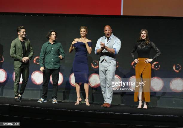 Actors Zac Efron Jon Bass Kelly Rohrbach Dwayne Johnson and Alexandra Daddario speak at Paramount Pictures' presentation highlighting its 2017 summer...
