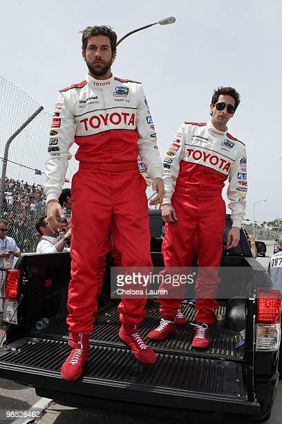 Actors Zachary Levi and Adrien Brody enter the track at the Toyota Grand Prix Pro / Celebrity Race Day on April 17 2010 in Long Beach California