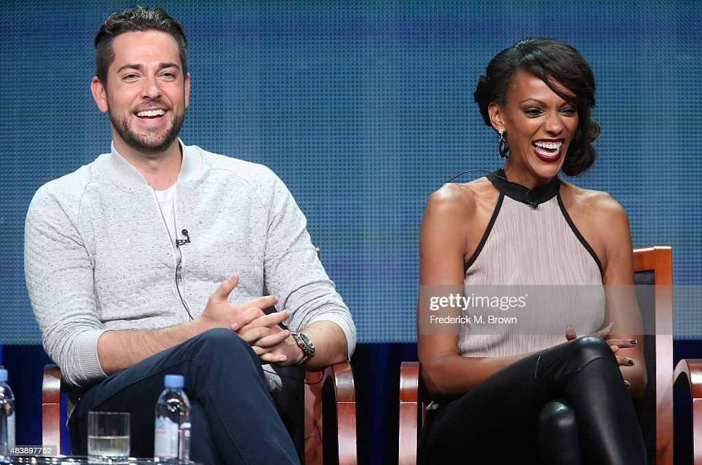 Actors Zachary Levi and Judi Shekoni speak onstage during NBC's 'Heroes Reborn' panel discussion at the NBCUniversal portion of the 2015 Summer TCA Tour at The Beverly Hilton Hotel on August 13, 2015 in Beverly Hills, California.