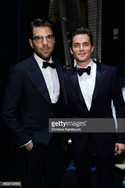 Actors Zachary Quinto and Matt Bomer pose backstage at the 68th Annual Tony Awards at Radio City Music Hall on June 8 2014 in New York City