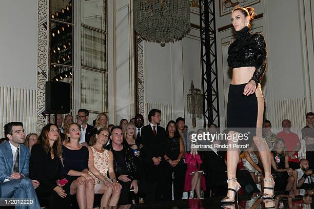 Actors Zachary Quinto Guest Uma Thurman Jo Levin and David Furnish attend the Versace show as part of Paris Fashion Week HauteCouture Fall/Winter...