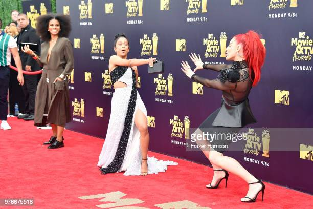 Actors Zazie Beetz and Liza Koshy and recording artist Justina Valentine attend the 2018 MTV Movie And TV Awards at Barker Hangar on June 16 2018 in...