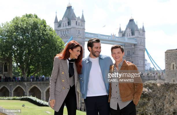 Actors Zendaya Jake Gyllenhaal and Tom Holland pose during a photocall for their latest film 'SpiderMan Far From Home' at the Tower of London...