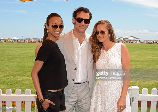 Actors Zoe Saldana, Clive Owen and Minka Kelly pose at the VIP Marquee during the fifth Annual Veuve Clicquot Polo Classic on June 2, 2012 in Jersey...