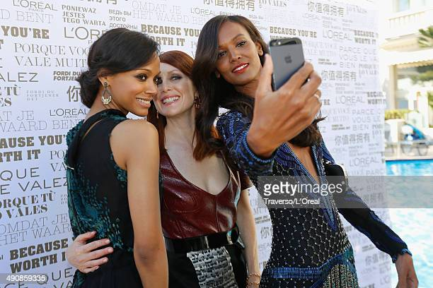Actors Zoe Saldana Julianne Moore and Liya Kebede take a selfie at the 'Mr Turner' premiere during the 67th Annual Cannes Film Festival on May 15...