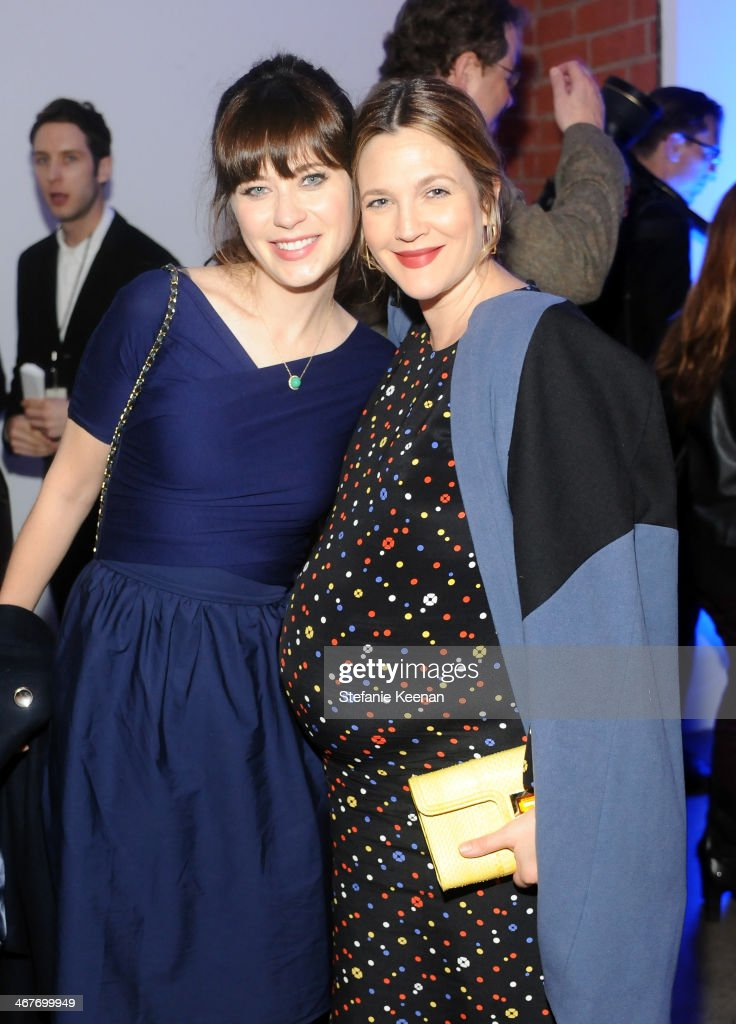 Actors Zooey Deschanel (L) and Drew Barrymore attend Hollywood Stands Up To Cancer Event with contributors American Cancer Society and Bristol Myers Squibb hosted by Jim Toth and Reese Witherspoon and the Entertainment Industry Foundation on Tuesday, January 28, 2014 in Culver City, California.