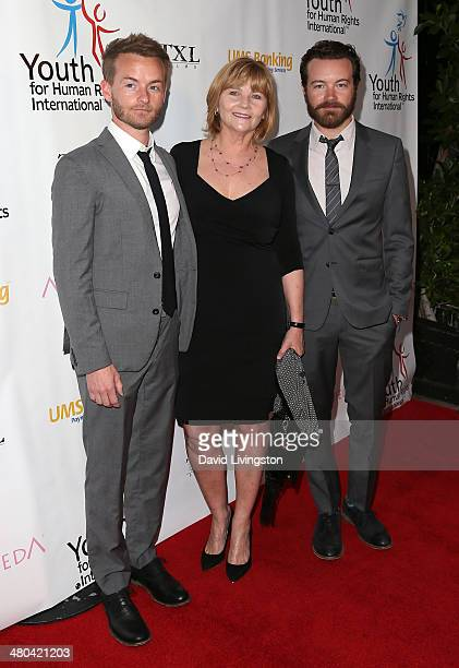 Actors/brothers Christopher Masterson and Danny Masterson pose with their mother Carol Masterson at the Youth for Human Rights International...