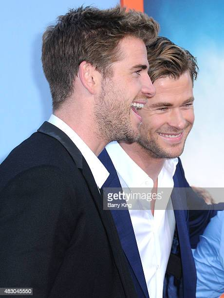 Actors/brothers Liam Hemsworth and Chris Hemsworth arrive at the Premiere Of Warner Bros. 'Vacation' at Regency Village Theatre on July 27, 2015 in...