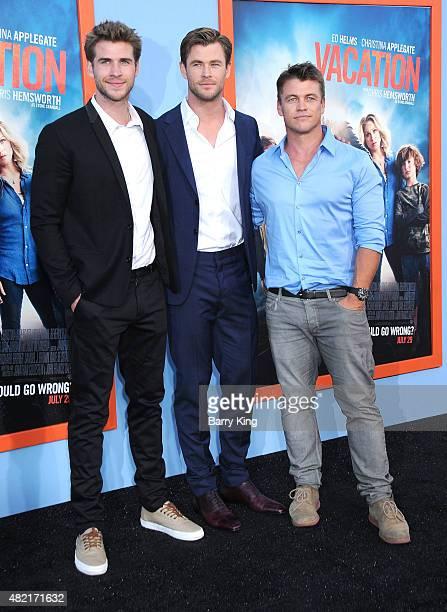 Actors/brothers Liam Hemsworth, Chris Hemsworth and Luke Hemsworth arrive at the Premiere Of Warner Bros. 'Vacation' at Regency Village Theatre on...