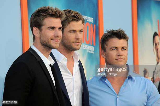 """Actors/brothers Liam Hemsworth, Luke Hemsworth and Chris Hemsworth arrive for the Premiere Of Warner Bros. Pictures' """"Vacation"""" held at Regency..."""