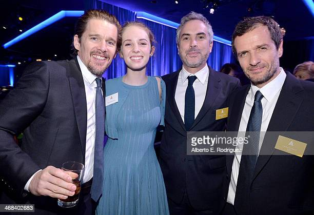 Actorscreenwriter Ethan Hawke daughter Maya ThurmanHawke Director Alfonso Cuaron and Producer David Heyman attend the 86th Academy Awards nominee...