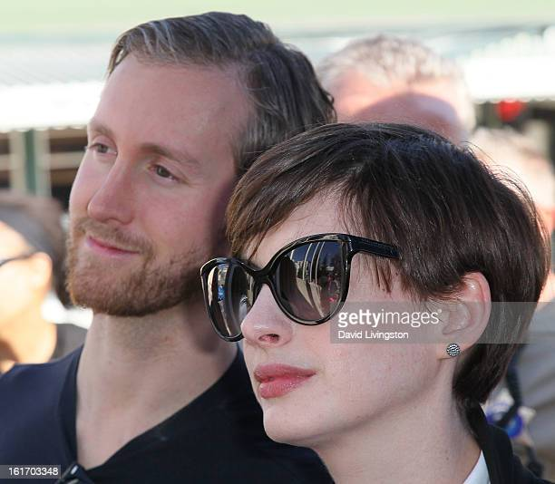 Actors/husband and wife Adam Shulman and Anne Hathaway attend the kickoff for One Billion Rising in West Hollywood on February 14 2013 in West...