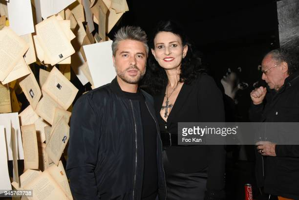 Actorsinger Anthony Dupray and Sylvie Ortega Munos attend the Maurice Renoma Serie Noire Exhibition At Renoma Store Rue De La Pompe on April 12 2018...