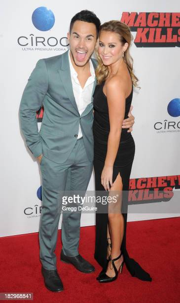 Actor/singer Carlos Pena Jr and actress Alexa Vega arrive at the Los Angeles premiere of Machete Kills at Regal Cinemas LA Live on October 2 2013 in...