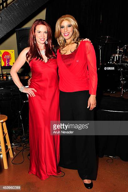 Actor/singer Chase Masterson and singer/flutist Kaylene Peoples attend the A Swingin' Christmas concert at the Indie Hotspot on December 5 2013 in...