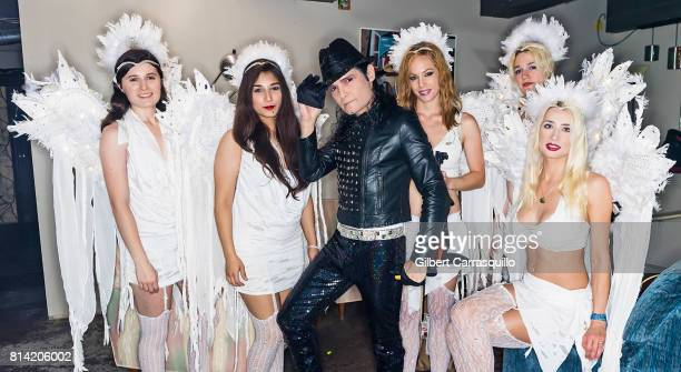 Actor/singer Corey Feldman poses backstage with drummer Marisa Testa guitarist Jimena Fosado keyboardist/violinist Margot Lane bass guitar Jezebel...