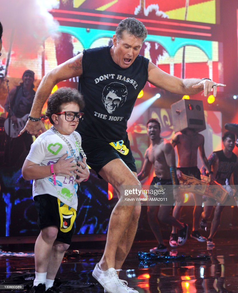 Actor/singer David Hasselhoff performs with LMFAO onstage at the 2011 American Music Awards held at Nokia Theatre L.A. LIVE on November 20, 2011 in Los Angeles, California.