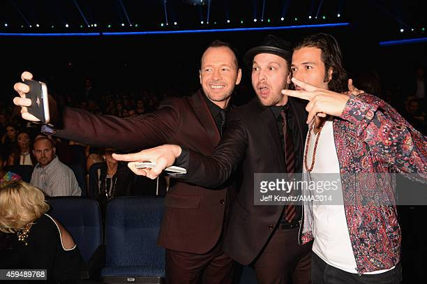 Actor/singer Donnie Wahlberg musicians Gavin DeGraw and Nasri attend the 2014 American Music Awards at Nokia Theatre LA Live on November 23 2014 in...