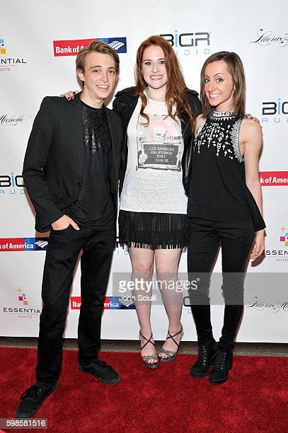 Actor/singer Dylan R Snyder singer/songwriter Laura Michelle and actress Allisyn Ashley Arm attend the album release party for Laura Michelle's...